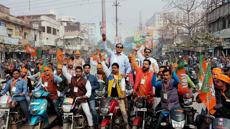 BJP workers welcome PM Narendra Modi at BHU in Varanasi.