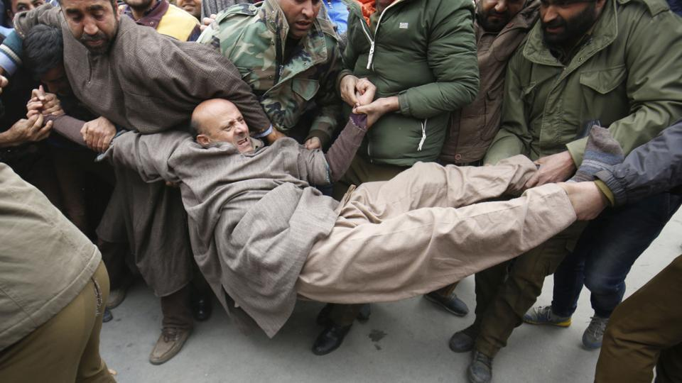 Policemen try to drag away indepenent MLA law maker Abdul Rashid Sheikh during a protest in Srinagar on 22 December 2016. Sheikh and nearly a dozen of his supporters were detained by police as they were protesting against reports of issuance of domicile certificates to West Pakistan refugees.