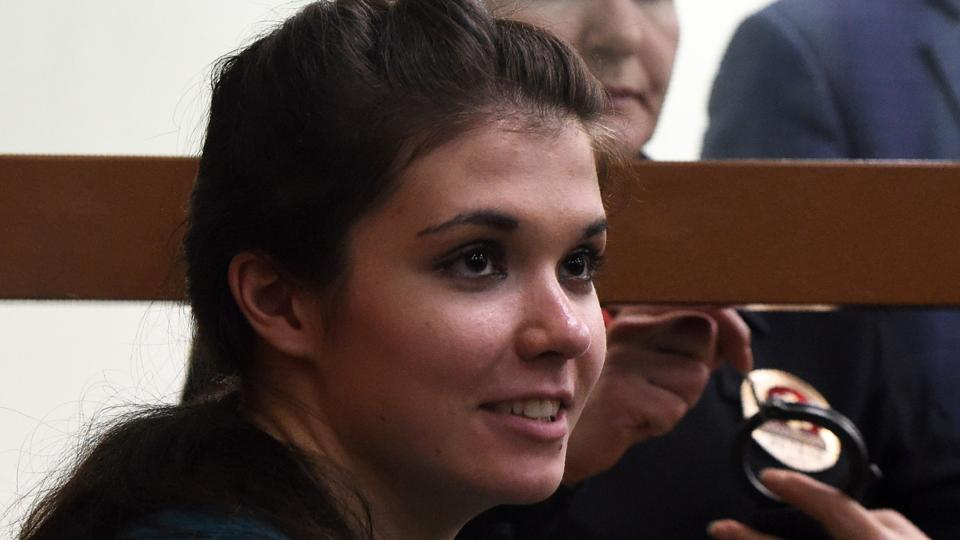 Moscow State University student Varvara Karaulova sits inside a defendants' cage during a hearing at Moscow's district military court on Thursday.