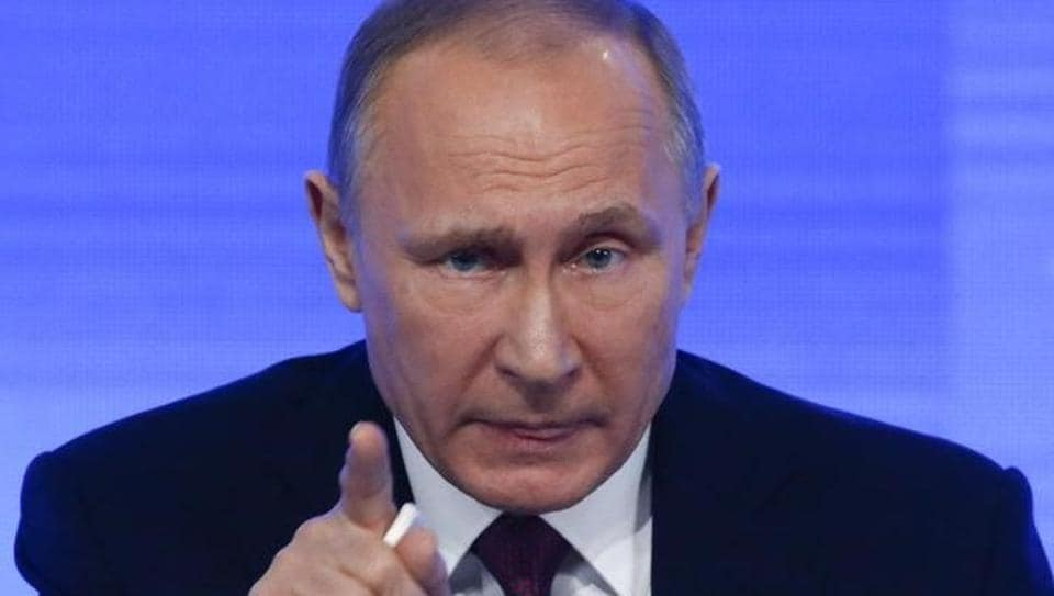 Russian President Vladimir Putin speaks during his annual end-of-year news conference in Moscow.
