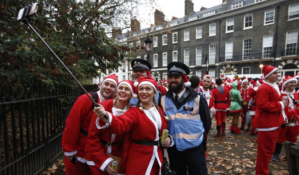Santas take part in the Santacon event, London, December 10