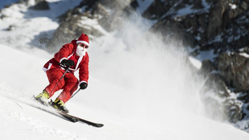 A man dressed as Santa Claus skis down the slope during a promotional event on the opening weekend in the alpine ski resort in Verbier. Around 1200 skiers dressed as Santa Claus were granted free access to the ski resort to celebrates the ski season's opening. (Jean-Christophe Bott/Keystone / AP)
