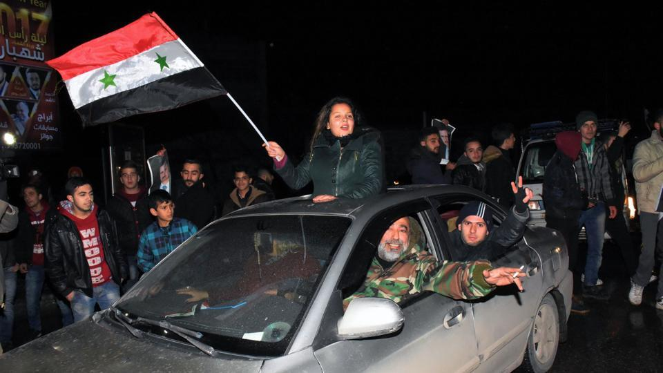 Syrians celebrate on December 22, 2016 in the northern Syrian city of Aleppo, after the army said it has retaken full control of the country's second city The army said it has retaken full control of Syria's devastated second city Aleppo, scoring its biggest victory against opposition forces since the civil war erupted in 2011.