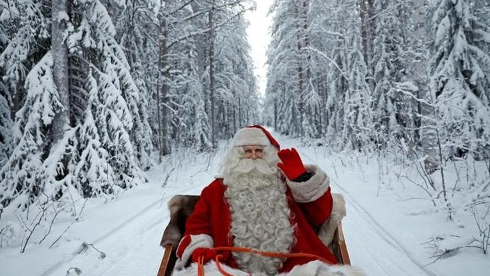 A person dressed as Santa Claus rides in his sleigh in the Arctic Circle near Rovaniemi, Finland. (Pawel Kopczynski / REUTERS)