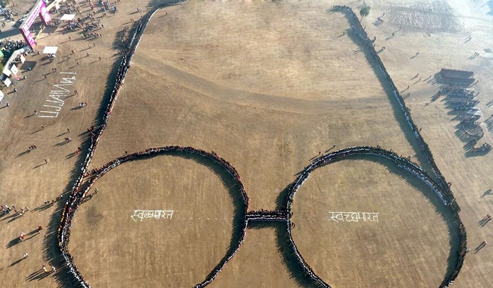 Human chain created in the form of Gandhi's spectacle in Ujjain on Friday.