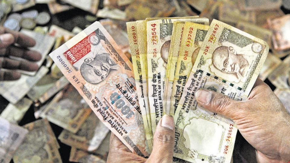 The Rs 500 and Rs 1,000 notes shown in picture have been scrapped as legal tender since November 8, but retailers, grocers and others continue to accept them.
