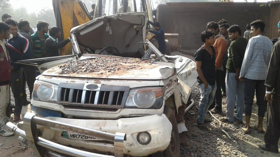 The car was crushed by a dumper.