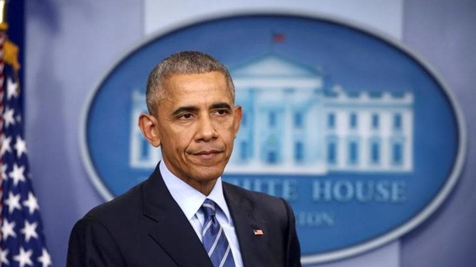 US president Barack Obama listens as he participates in his last news conference of the year at the White House in Washington.