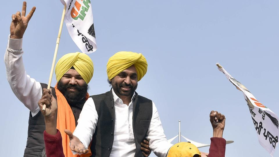 AAP leader Bhagwant Mann and party's candidate from Majitha Himmat Singh Shergill during a road show at Nagkalan village in Majitha constituency in Amritsar on Friday.