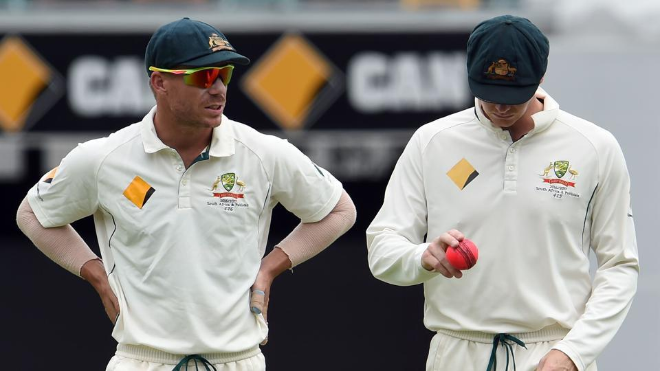 Australia's captain Steve Smith (R) and teammate David Warner talk during the fifth Test match against Pakistan.