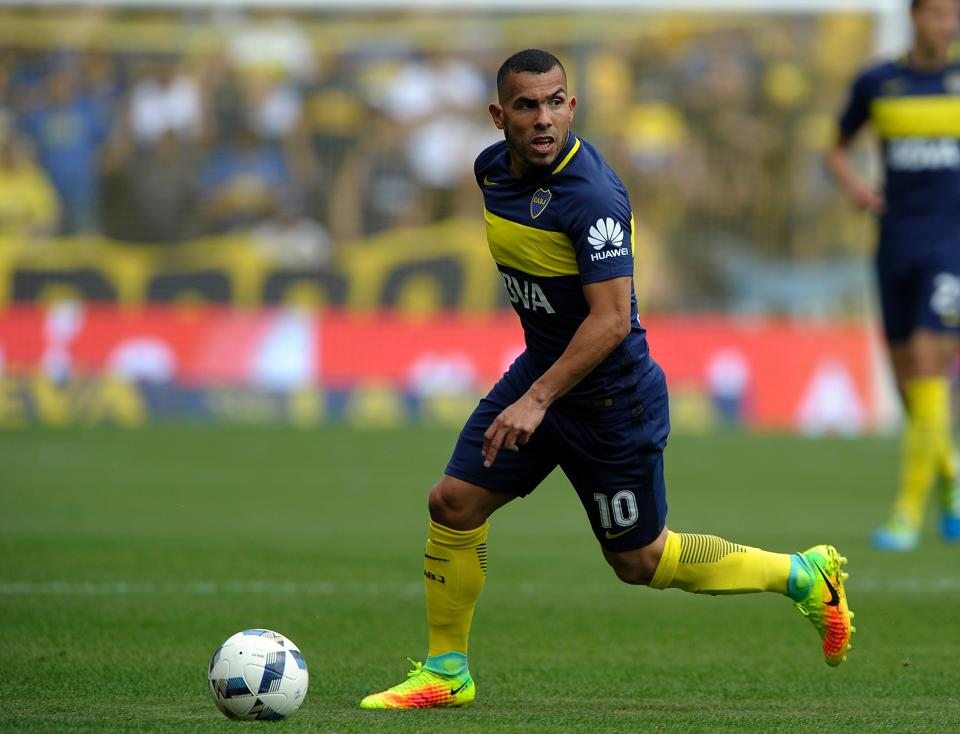 Carlos Tevez controls the ball during the Argentina First Division football match against Sarmiento.