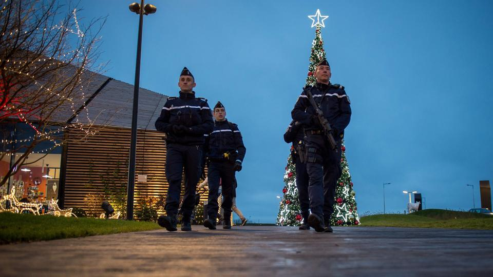 French Gendarmes patrol at the Christmas market in Tours, central France.