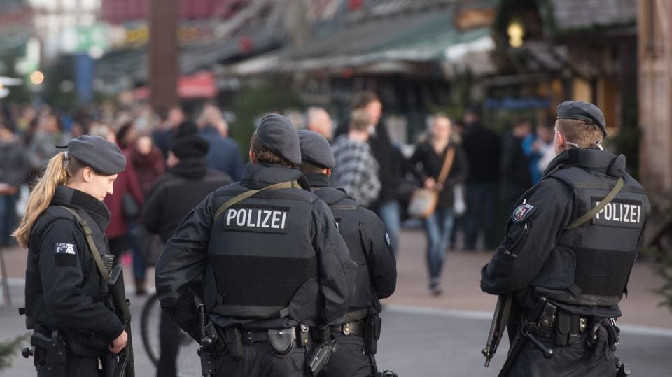 Armed police patrol at the Christmas market outside the Centro, one of Germany's largest shopping and leisure centers, in Oberhausen, western Germany.