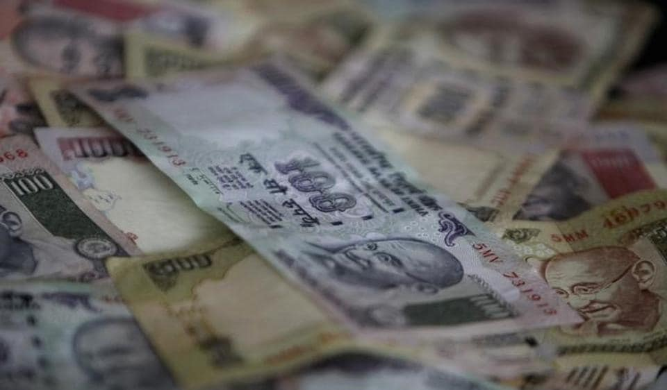 The police have arrested two people who opened nine accounts in the Naya Bazar branch of Kotak Mahindra Bank, in which they deposited R34 crore in scrapped banknotes.