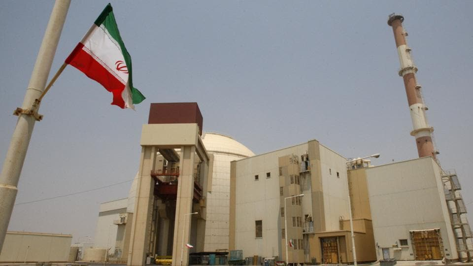 An Iranian flag flutters in front of the reactor building of the Bushehr nuclear power plant, just outside the southern city of Bushehr, Iran.