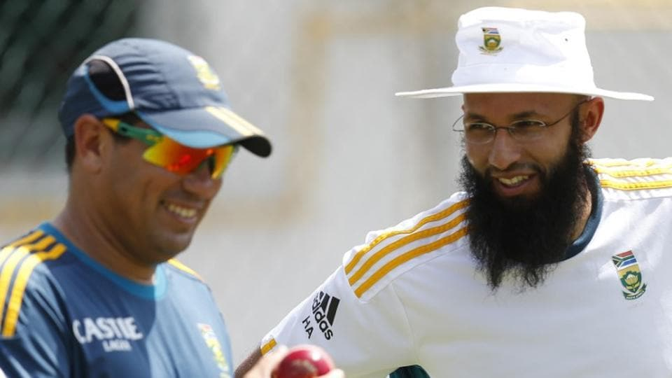 South Africa's Hashim Amla (R) talks with team coach Russell Domingo during a practice session ahead of their Test match against Sri Lanka.