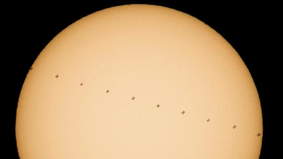 This Nasa composite image, made from ten frames, shows the       International Space Station, with a crew of six on-board, in       silhouette as it transits the sun at roughly five miles per       second.      (Joel Kowsky/Nasa/AFP Photo)