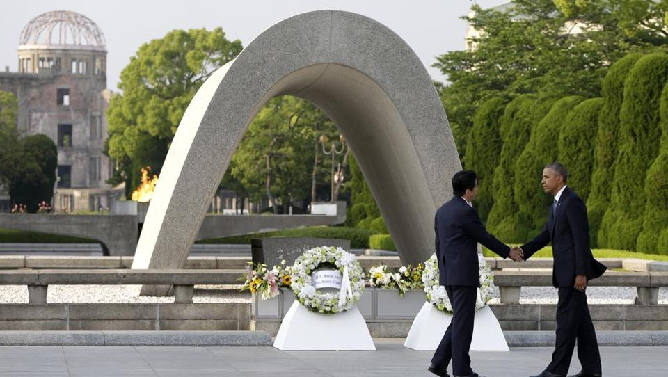 US President Barack Obama, shakes hands with Japanese Prime Minister Shinzo Abe at Hiroshima Peace Memorial Park in Hiroshima, western Japan.