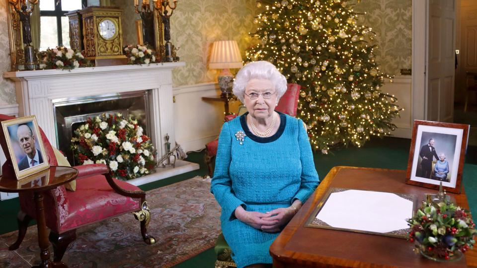 Britain's Queen Elizabeth II sits at a desk in the Regency Room in Buckingham Palace in London, after recording her Christmas Day broadcast to the Commonwealth on December 25, 2016.