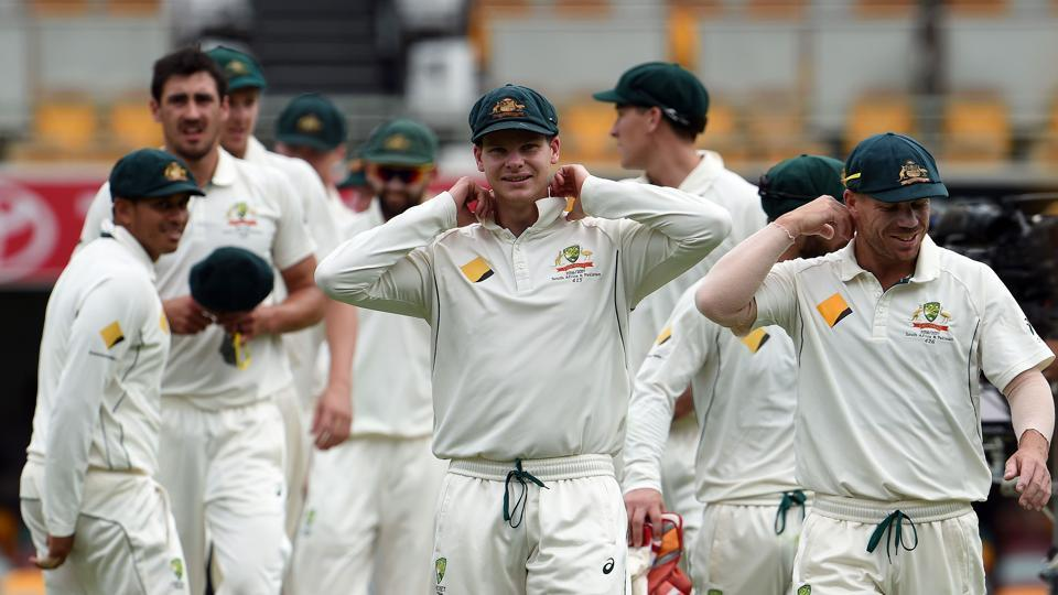 Australia's captain Steve Smith (C) adjusts his collar as he walks off the field with teammates after beating Pakistan  in the first Test.