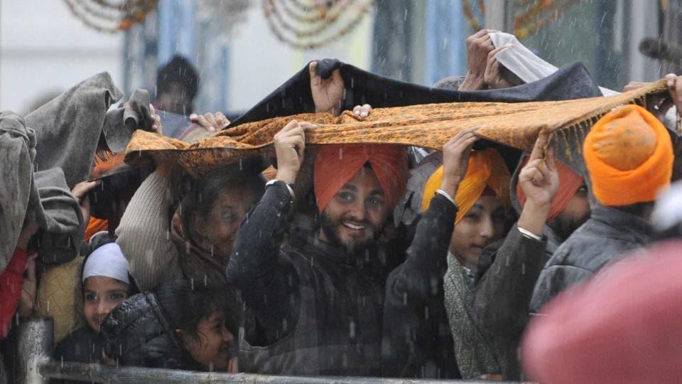Devotees outside Gurdwara Fatehgarh Sahib on the occasion of the annual Shaheedi Jor Mela on Sunday in Fatehgarh Sahib town.