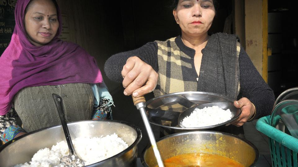 Cooks preparing and serving midday meal at Government Model Senior Secondary School, Cemetery Road, in Ludhiana on Saturday.