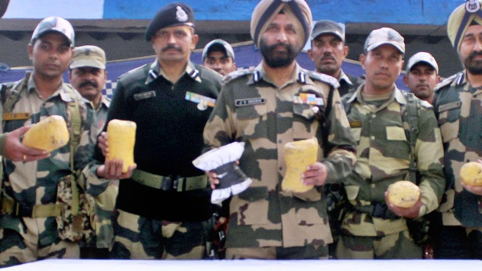 BSF officials showing seized contraband, 7 kg heroin,  from Border Out Post (BOP) Bharopal in the Amritsar sector of the Indo-Pak border on Saturday.