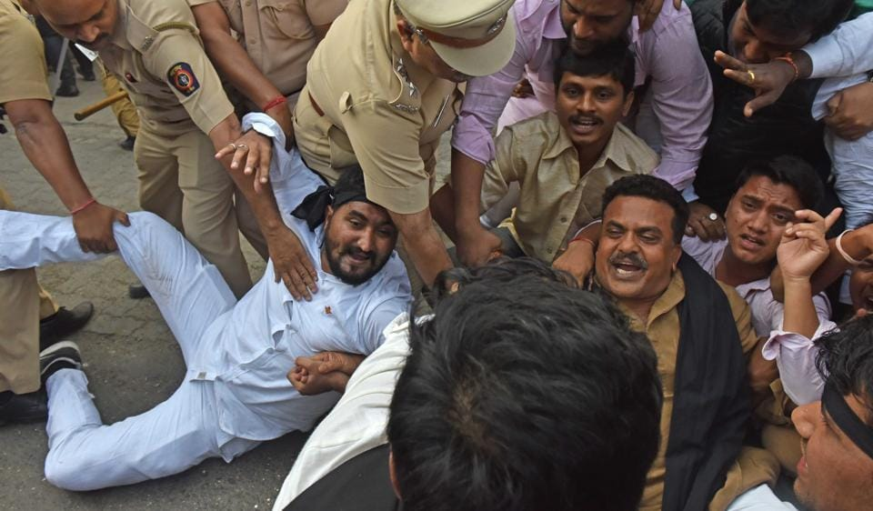 Mumbai Congress president Sanjay Nirupam (centre) is detained after he violated his house arrest to step out on the streets and protest against the government's demonetisation move.