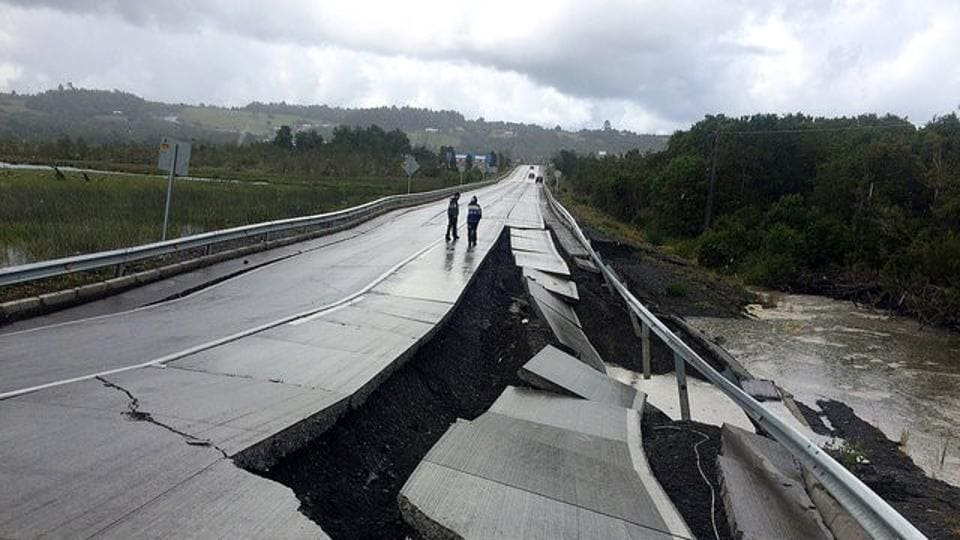 A damaged road is seen after a quake at Tarahuin, on Chiloe island, southern Chile.