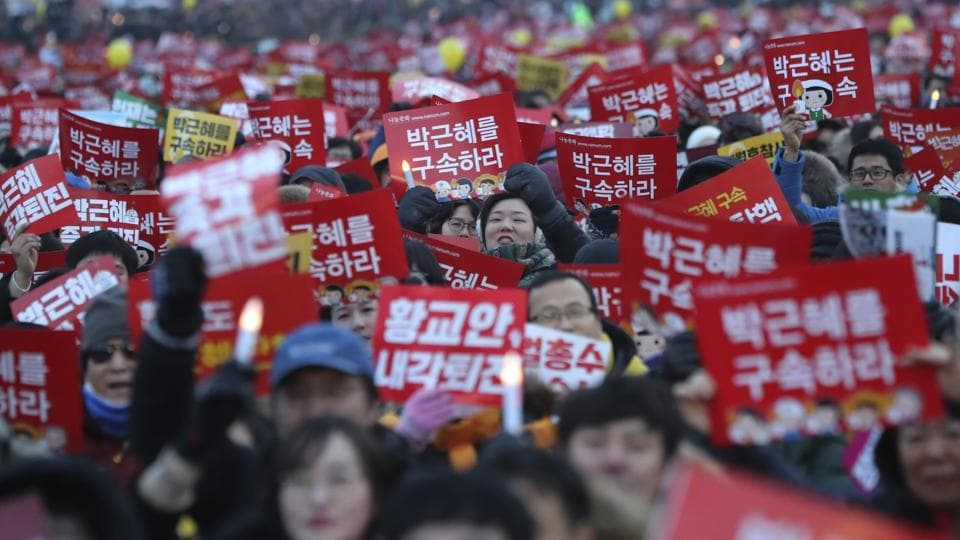 Protesters shout slogans during a rally calling for South Korean President Park Geun-hye to step down in Seoul, South Korea, Saturday.