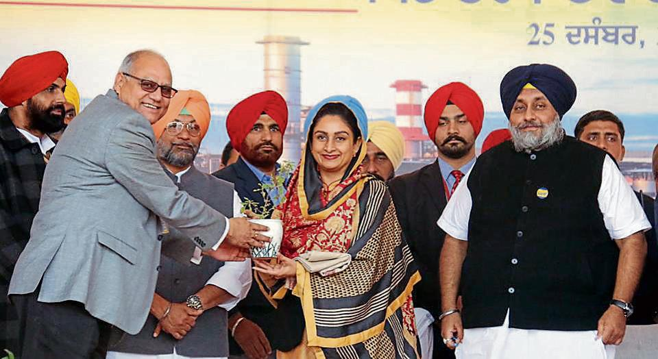Executive director of the Hindustan Petroleum Corporation Limited Anil Pandey honouring Union minister for food processing industries Harsimrat Kaur Badal at the foundation stone-laying ceremony of the bioethanol plant in Bathinda on Sunday.