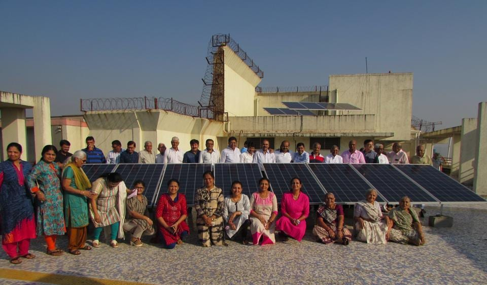 Residents of Shivshakti Heights with the solar power panel installed on their terrace.