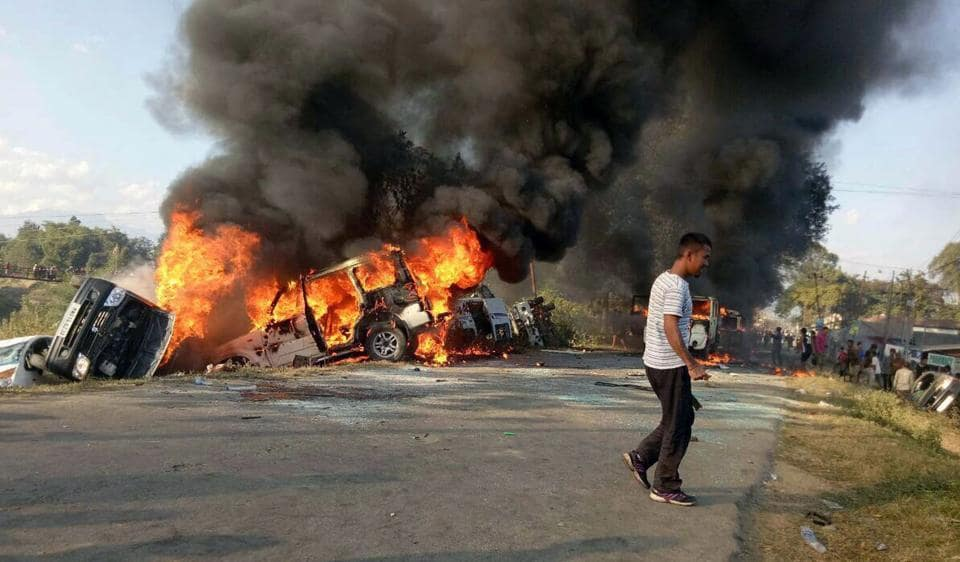 Vehicles set alight by protesters in Imphal, Manipur.
