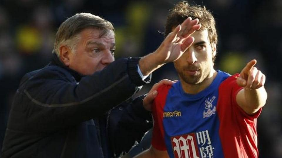 Manager Sam Allardyce with Crystal Palace's Mathieu Flamini.  Palace began life under Sam Allardyce with a 1-1 draw at Watford on Monday