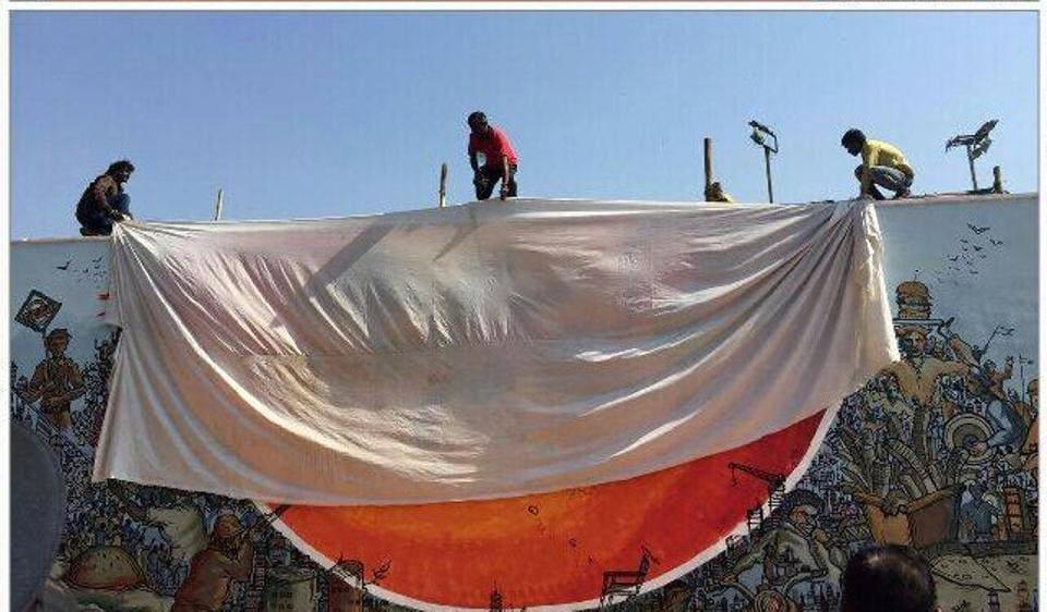 Shiv Sainiks cover the mural showing Hindu goad Hanuman at IIT-B on Monday.