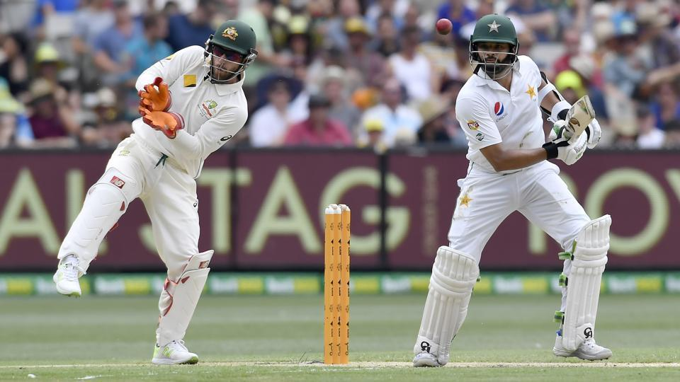 Pakistan's Azhar Ali, right, hits a cut shot on the first day of their second cricket test in Melbourne.