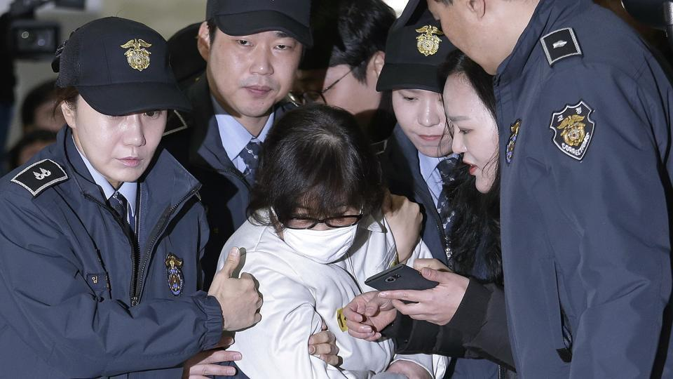 In this Saturday photo, Choi Soon-sil, the jailed confidante of disgraced South Korean President Park Geun-hye, arrives for questioning into her suspected role in political scandal at the office of the independent counsel in Seoul.