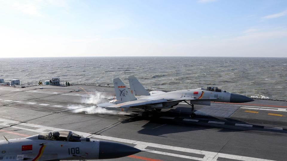 A Chinese J-15 fighter jet lands on the deck of the Liaoning aircraft carrier during military drills in the Bohai Sea, off China's northeast coast.