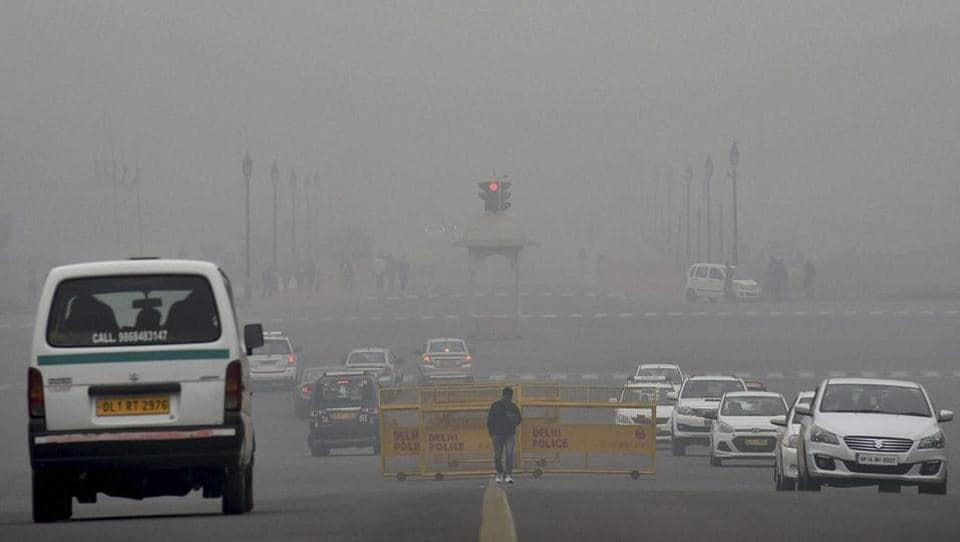 A thick layer of dense fog envelops Rajpath on a cold winter morning in New Delhi on Sunday.