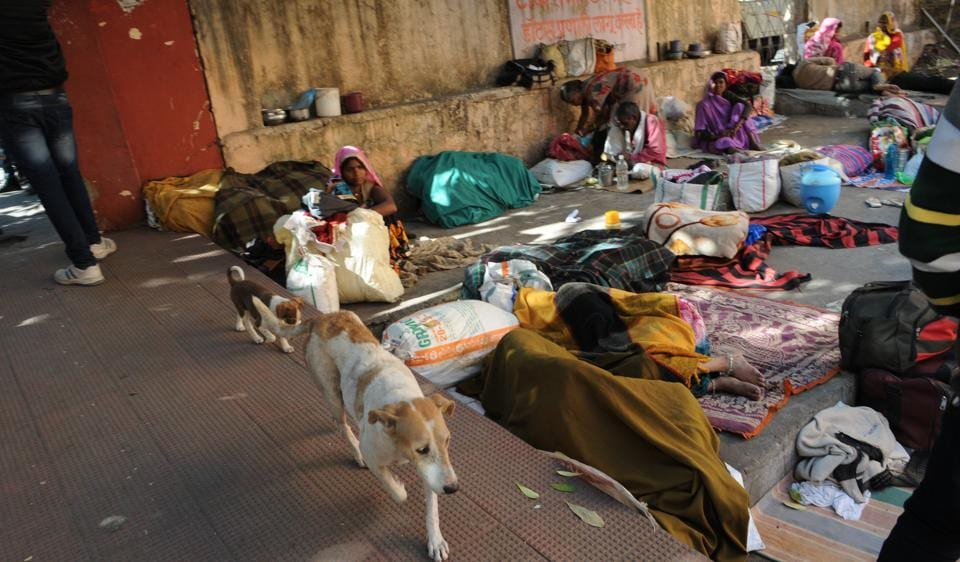 People take rest at the shed on hospital premises. The chief minister has cancelled the tender of the agency appointed for cleaning hospital premises.