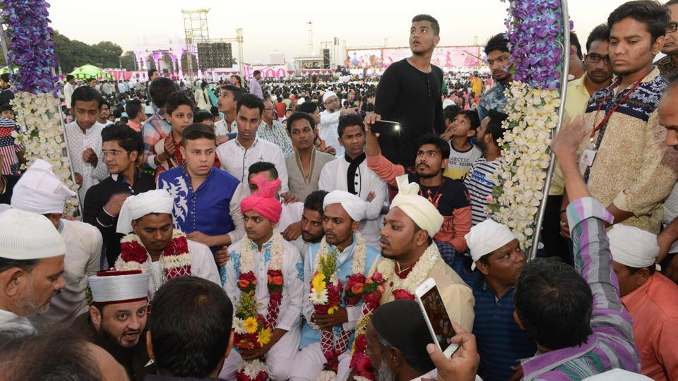 Five Indian Muslim grooms assemble at a mass wedding of 236 fatherless girls organised by the charitable PP Savani Group in Surat, some 270 km from Ahmedabad. Out of 236 fatherless girls married in the mass wedding event, five were from the Muslim community, and one Christian, with the majority being Hindus. / AFP PHOTO / SAM PANTHAKY