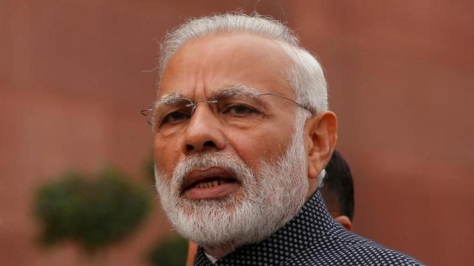 Prime Minister Narendra Modi speaks to the media inside the parliament premises on the first day of the winter session in New Delhi.