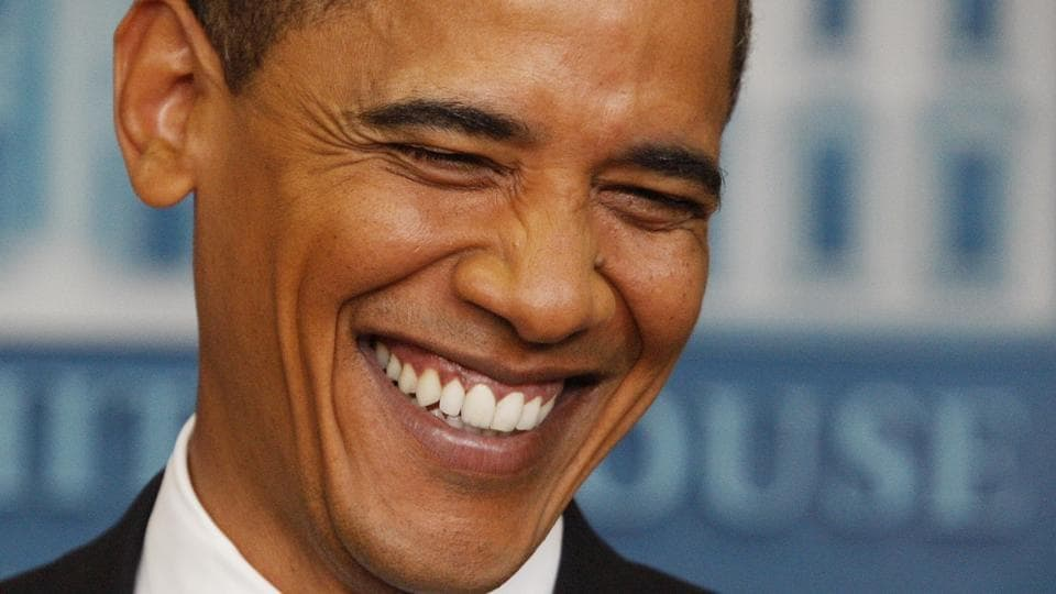 US President Barack Obama smiles as he listens to a question during a news conference at the White House in Washington.