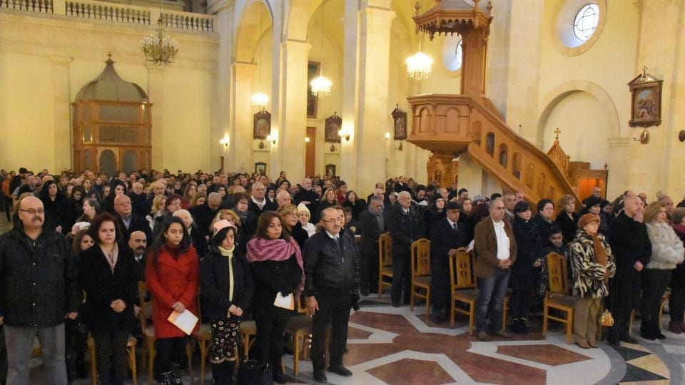 Christians attend a mass at the Latin Church in Aleppo's Azizia neighbourhood on December 25, 2016.