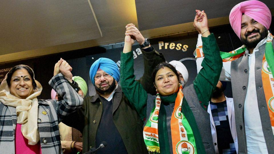 Punjab Congress chief Captain Amarinder Singh and Asha Kumari, in-charge of party affairs in state, welcoming former AAP leader Yamini Gomar and Bains brothers' ex-aide Kamaljit Singh Karwal into the party fold inChandigarh onSunday.