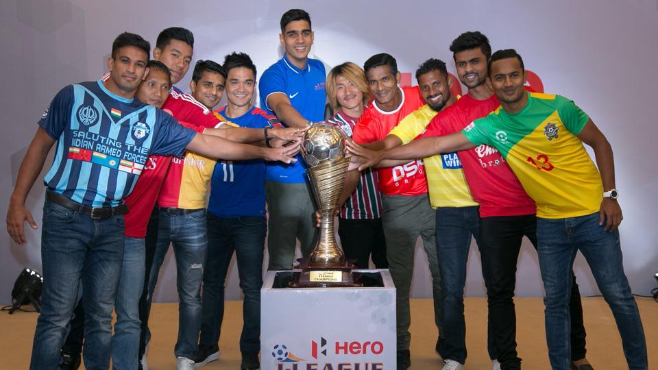 Players representing the 10 teams that will feature in the 10th I-League tournament pose with the trophy. The league's new edition was launched in New Delhi on Tuesday.