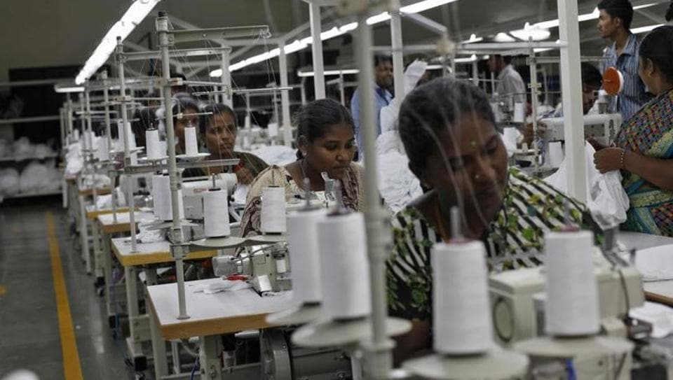 A file photo of employees sew clothes at a factory in Tirupur, Tamil Nadu.