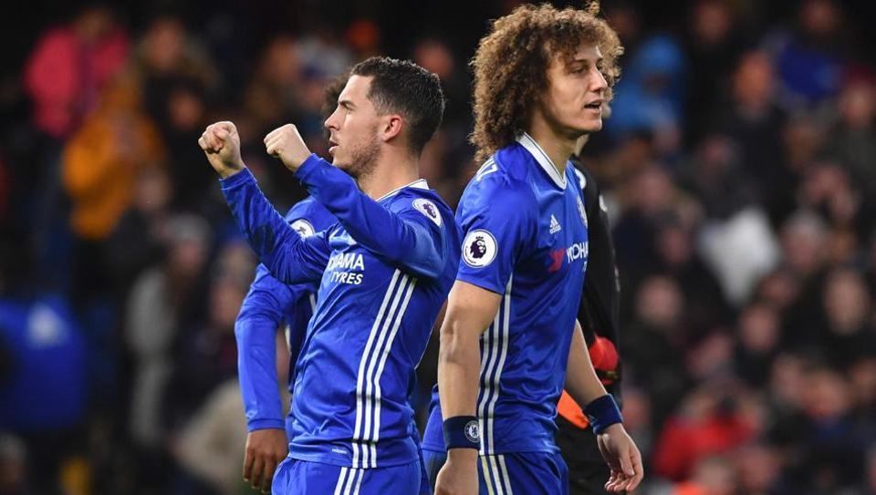 Chelsea's Belgian midfielder Eden Hazard (left) celebrates scoring his team's second goal during a Premier League football match against Bournemouth at Stamford Bridge on Monday.