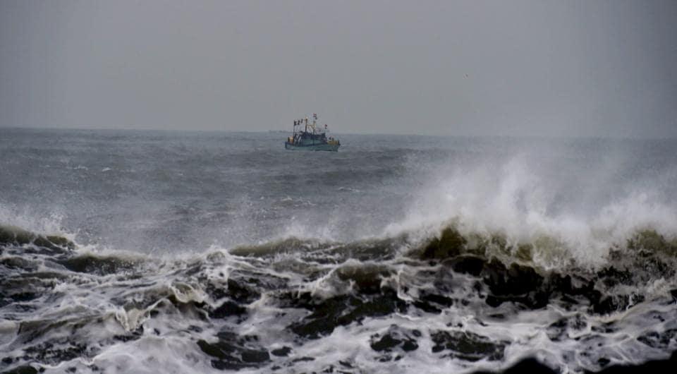 Fishermen return to harbour in Chennai.