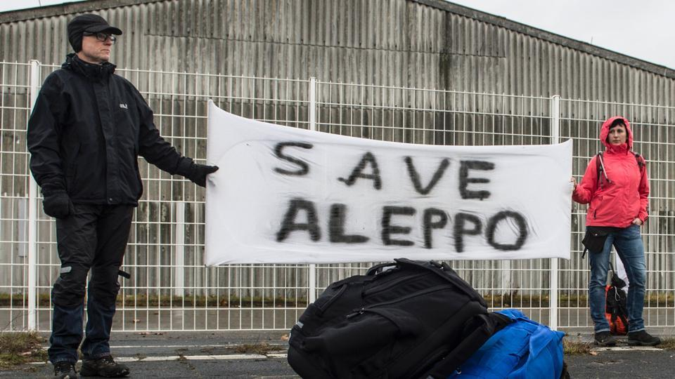 Participants of the solidarity march to Aleppo hold a banner reading